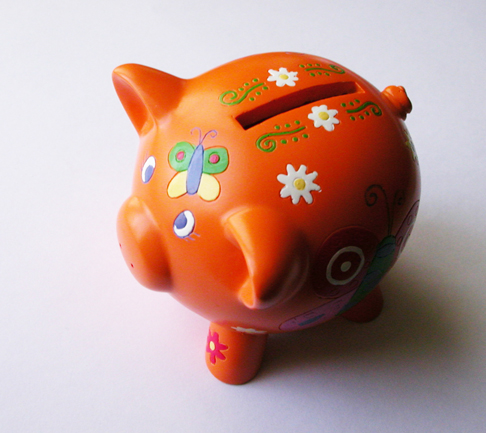 A decorative piggy bank. Best Collateral's interest free layaway program.