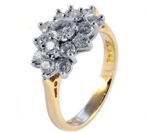 A diamond ring with round cut diamonds set in a gold band.