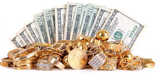 A fan of cash begind a pile of gold jewelry and coins. Cash for gold San Francisco.