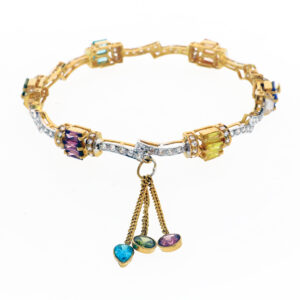 Ladies Bangle in 22K Yellow Gold with colored stone dangling from gold chain