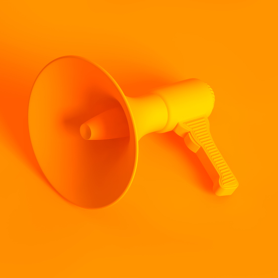 A yellow loudspeaker on a matching yellow background